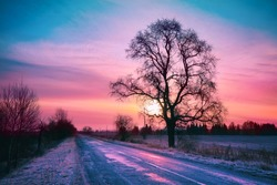 Beautiful winter sunrise over road