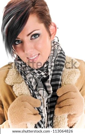 Beautiful Winter Woman wearing Coat, Scarf and Mittens