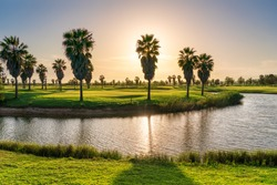 Beautiful, with green grass, golf course, and pond. On the Sunset, Portugal, Algarve.