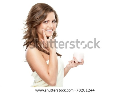 beautiful woman after bath holding jar with cream