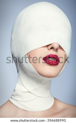 Beautiful woman after plastic surgery with bandaged face