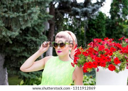 beautiful woman and beautiful Petunia, beautiful bright women summer theme and flowers