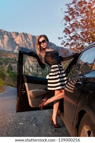 Beautiful woman and car