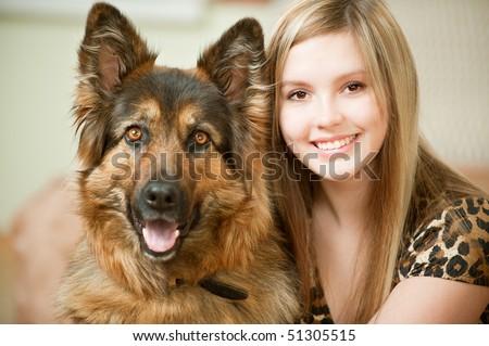 Beautiful woman and its sheep-dog close up.