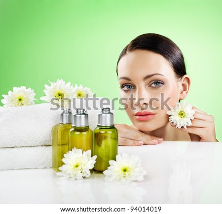 Beautiful woman and organic cosmetic. Space for text. - stock photo