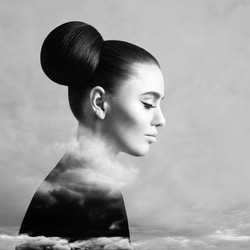 Beautiful woman and sky cloud above background, black and white art portrait