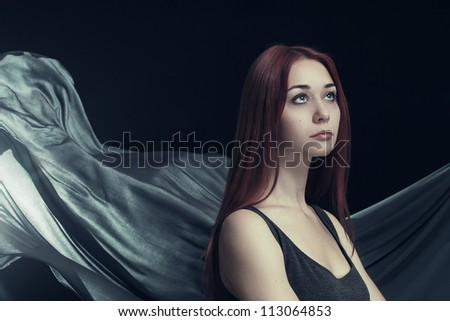 beautiful woman and waving cloth as background