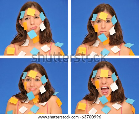 beautiful woman ans sticky notes isolated over blue