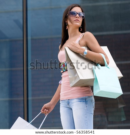 Beautiful woman at a shopping center with bags