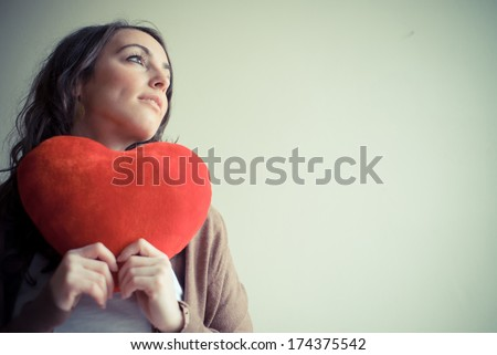 beautiful woman at home with heart for valentine's day