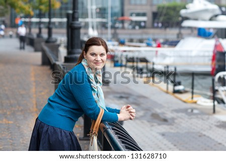 Beautiful woman at the autumn port in New York - stock photo
