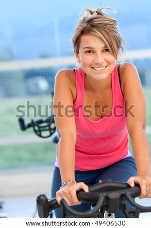 beautiful woman at the gym and smiling