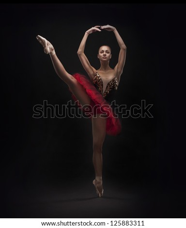 beautiful woman ballet dancer isolated on black background
