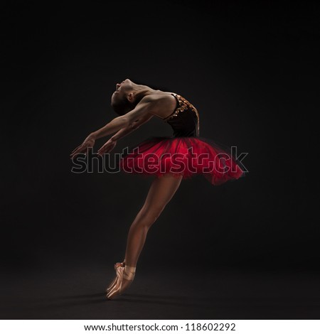 beautiful woman ballet dancer isolated on studio black background