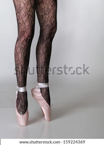 beautiful woman ballet dancers legs gray background