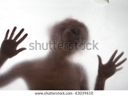 Beautiful woman behind the shower curtain relaxing