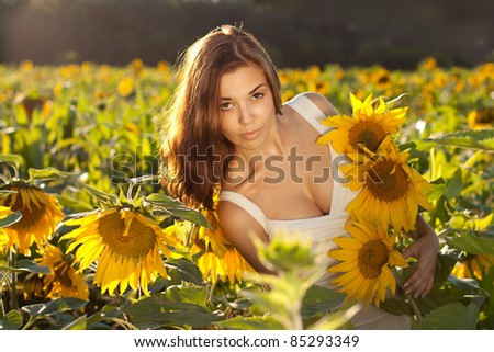 beautiful woman between sunflowers
