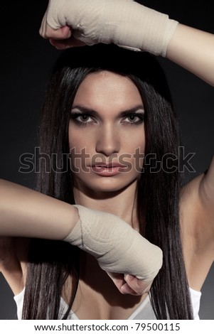 beautiful woman boxer portrait wearing bandage on hands