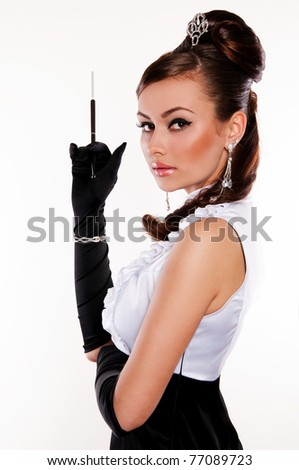 beautiful woman brunette like Audrey Hepburn with mouthpiece on white background