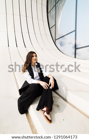 beautiful woman business suit posing at the camera