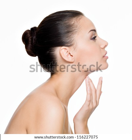 Beautiful woman cares for the skin neck- posing at studio isolated on white