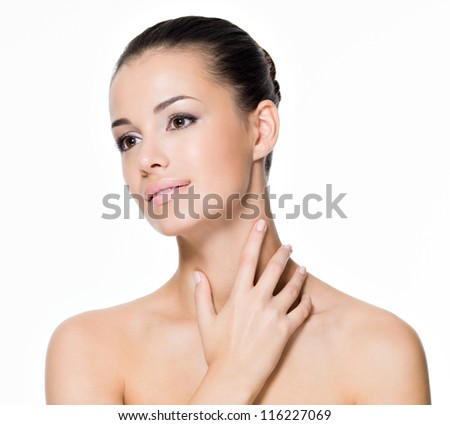 Beautiful woman cares of neck- posing at studio  isolated on white