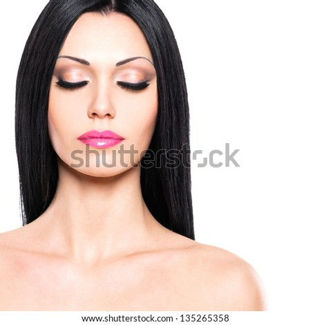 Beautiful woman cares of the skin face isolated on white background. Beauty portrait of the pretty woman with closed eyes