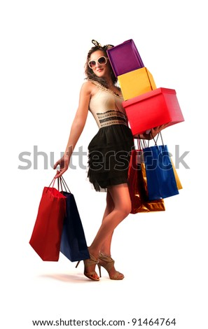 Beautiful woman carrying many shopping bags - stock photo
