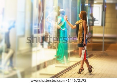 Beautiful woman carrying many shopping bags on a city street