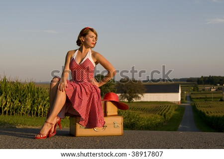 beautiful woman catching a ride in the Pennsylvania country side