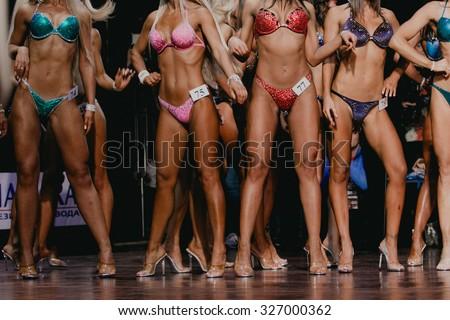 beautiful woman chest and flat tummies. competition fitness bikini