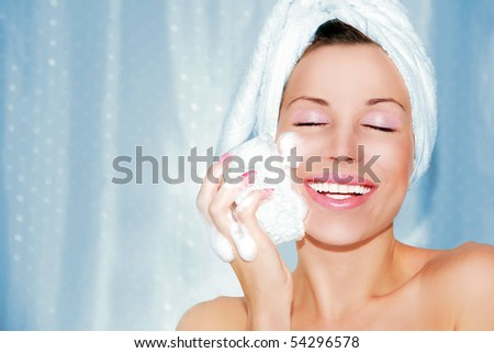 beautiful woman cleaning face. Beauty treatment
