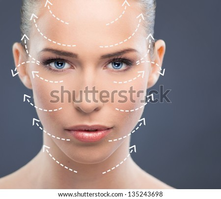 Beautiful woman close up over a  blue background with arrows