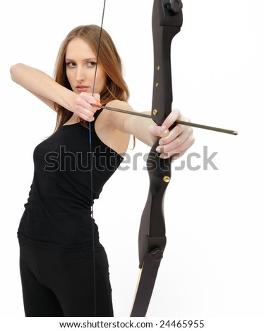 Beautiful woman concentrating and aiming with bow and arrow