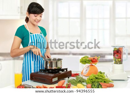 Beautiful woman cooking something in the kitchen