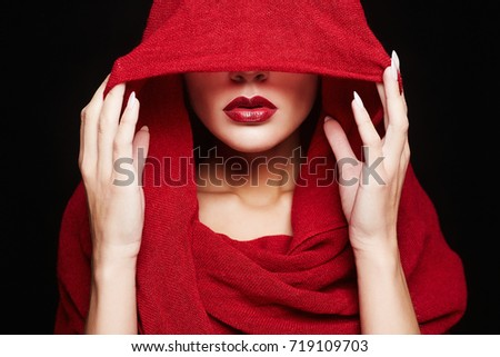 beautiful woman covers her face with a red cloth.red lips girl under hood. a20b0d5a67cb