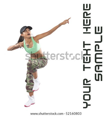Beautiful woman dancer in hip hop attire striking a pose, pointing upwards.