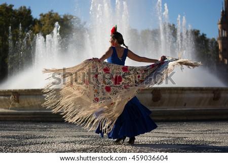 Beautiful woman dancing flamenco near the fountain Foto stock ©