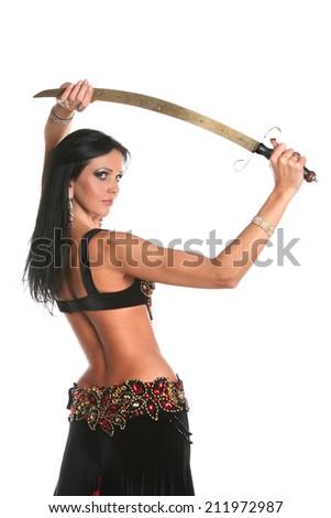 beautiful woman dancing in colorful Arabic dance costume. beautiful brunette. long hair .dance with saber.