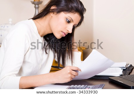 beautiful woman doing finances at home