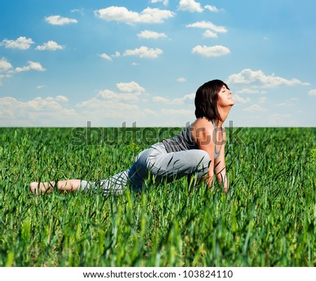 beautiful woman doing sport exercises at the field