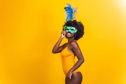 Beautiful woman dressed for carnival night. Black woman with carnival mask