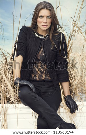 beautiful woman dressed in black stylish suit