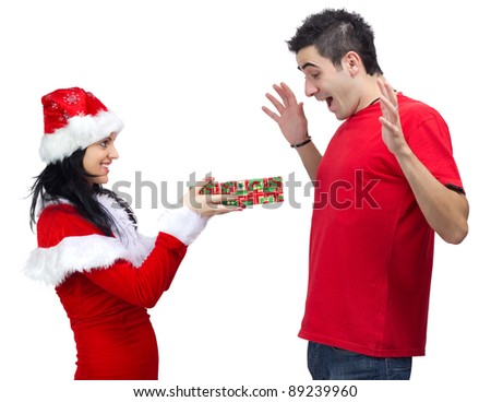 Beautiful woman dressed in Santa Claus offering a gift to young happy man.White background.