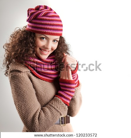 beautiful woman dressed in winter clothes smiling - studio shots