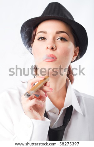 beautiful woman dressing in man's clothing holding a cigar