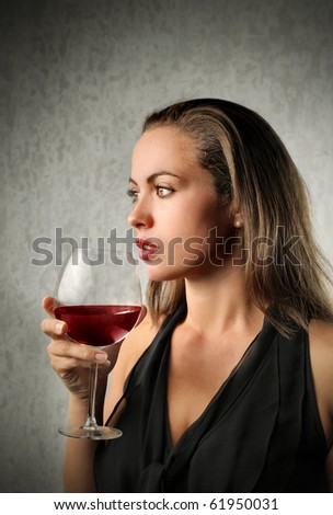 Beautiful woman drinking a glass of wine