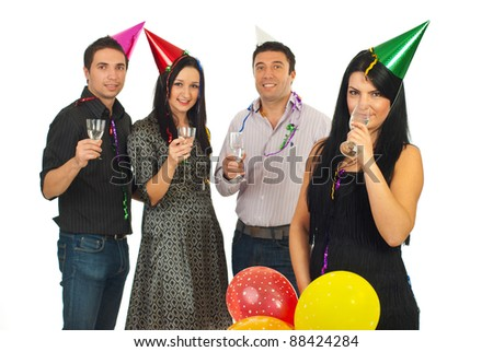 Beautiful woman drinking champagne in front of her friends at new year party night isolated on white background
