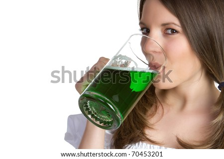 Beautiful woman drinking green beer