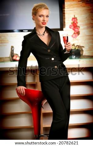 Beautiful woman drinking pink wine at bar